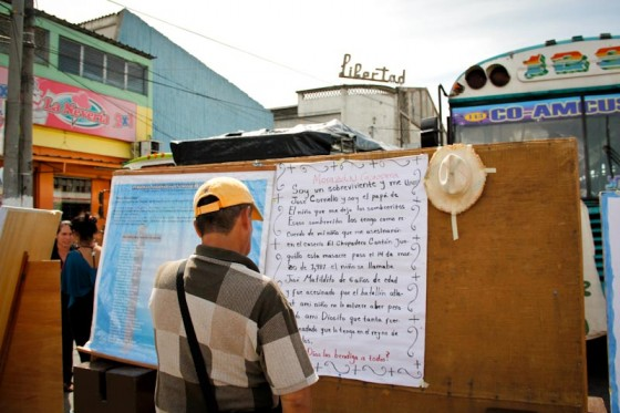 "Photo of a man at the annual ""Meeting of Victims"" reading a poem written by the father of a child killed by the military in El Salvador."