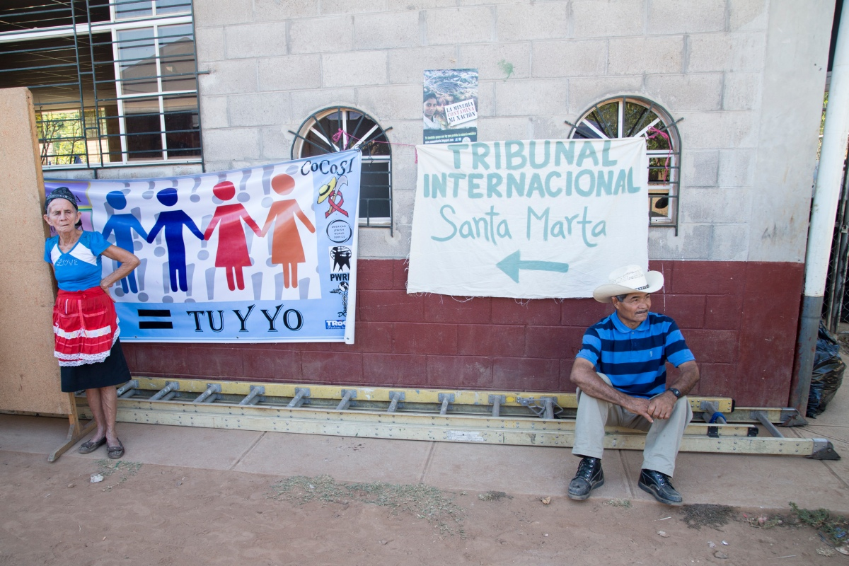 Santa Marta residents wait by the entrance of the community center where the Tribunal will take place.