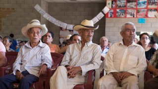 Photo of three elder men attending the Tribunal.