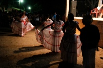 A group of Salvadoran women in traditional dress begin to dance at an evening cultural event in Santa Marta.